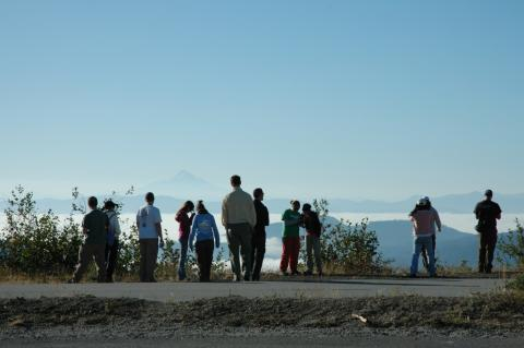 People looking over mountain