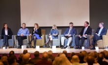 Kim Cobb (left) discussing sea-level rise with other experts (Photo by The New Brunswick News)