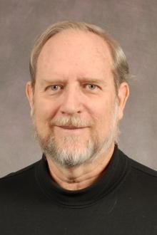Dr. E. Michael Perdue