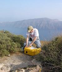 EAS Undergraduate Grant Farmer (Class of 2008) installing equipment in Santorini, Greece